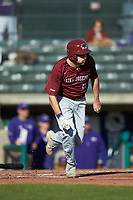 Luke Zimmerman (15) of the Saint Joseph's Hawks hustles down the first base line against the Western Carolina Catamounts at TicketReturn.com Field at Pelicans Ballpark on February 23, 2020 in Myrtle Beach, South Carolina. The Hawks defeated the Catamounts 9-2. (Brian Westerholt/Four Seam Images)