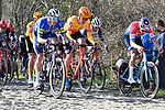 The peloton including Dutch Champion Mathieu Van Der Poel (NED) Alpecin Fenix on the cobbles during the 73rd edition of Kuurne-Brussel-Kuurne 2021 running 197km from Kuurne to Kuurne, Belgium. 28th February 2021  <br /> Picture: Serge Waldbillig | Cyclefile<br /> <br /> All photos usage must carry mandatory copyright credit (© Cyclefile | Serge Waldbillig)