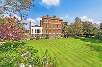 BNPS.co.uk (01202 558833)<br /> Pic: KnightFrank/BNPS<br /> <br /> Pictured: The garden.<br /> <br /> A spectacular Georgian mansion that was home to an eccentric and legendary poet during the war is on the market for £10.5m.<br /> <br /> Grade II* Listed South End House was home to Walter de la Mare in the 1940s and the writer was reprimanded for failing to observe the blackout during the Second World War.<br /> <br /> The impressive property is in a prime location on an exclusive cul-de-sac with incredible park views and glimpses of the Thames.<br /> <br /> On one occasion during the war, police rowed across the river to complain his upper windows were beaconing to the far bank.