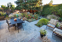 Small space backyard dining patio with stone, flagstone pavers, Lundstrom Garden, design by Susan Morrison