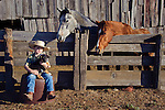 Ethan with Buddy at the corrals. The ranch in San Luis Obispo, California