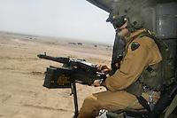 """- helicopter of the airborne brigade """"Friuli"""" during a territory control operation in the desert....- elicottero della brigata aeromobile """"Friuli""""  durante una operazione di controllo del territorio nel deserto.."""
