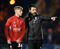 Lincoln City's Jon Smith, left, with Lincoln City manager Danny Cowley during the pre-match warm-up<br /> <br /> Photographer Chris Vaughan/CameraSport<br /> <br /> The EFL Sky Bet League Two - Lincoln City v Exeter City - Tuesday 26th February 2019 - Sincil Bank - Lincoln<br /> <br /> World Copyright © 2019 CameraSport. All rights reserved. 43 Linden Ave. Countesthorpe. Leicester. England. LE8 5PG - Tel: +44 (0) 116 277 4147 - admin@camerasport.com - www.camerasport.com
