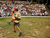 Boy Scouts attending Boy Scout resident camp at Camp Raven Knob in summer 2010 joke around while waiting for a ceremony to start (during a visit from parents). Camp Raven Knob Scout Reservation, one of the largest Boy Scout camps in the United States, is located within Boy Scouts of America's Old Hickory Council in Mt. Airy, North Carolina. Troops from across the US attend the camp's one-week residential boys' summer programs, which offer instruction on more than 40 merit badges, adventure programs and new Scout orientation.