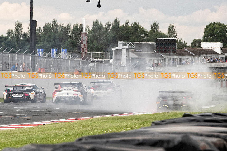 Drivers avoid the debris from the collision as Harry Hayek & Katie Milner, McLaren 570S GT4, Team Rocket RJN remains stricken during the British GT & F3 Championship on 11th July 2021
