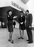 Their roles may be reversed. Amram Zur; 50; as director general of Israeli's Expo pavilion; gives the orders to guides Kaya Harverd; 21 (left); and Netta Efrony; 24. But things will change if Israel goes to war. Zur; a private in the Israeli army; will have to salute Miss Harverd; a lieutenant. Things won't change for Miss Efrony - she's a private; too.<br /> <br /> 1967<br /> <br /> PHOTO :  Dick Darrell - Toronto Star Archives - AQP