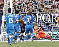 Philadelphia Union goalkeeper Zac MacMath (18) pounces on the ball. In a Major League Soccer (MLS) match, the New England Revolution (dark blue) defeated Philadelphia Union (light blue), 5-1, at Gillette Stadium on August 25, 2013.