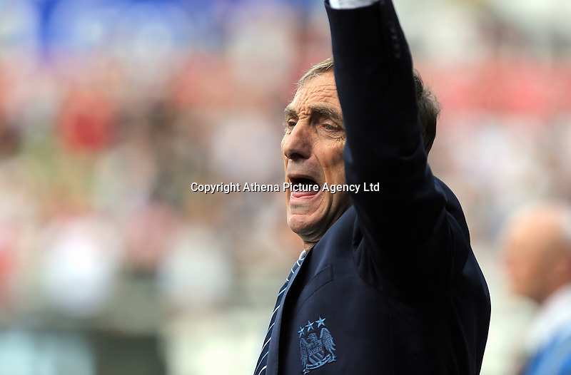Assistant coach cheers on at the final whistle during the Swansea City FC v Manchester City Premier League game at the Liberty Stadium, Swansea, Wales, UK, Sunday 15 May 2016