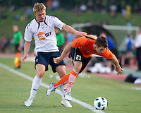 Johan Elmander (BW) pushes Chad Smith (CE) off the ball.  The Charlotte Eagles currently in 3rd place in the USL second division play a friendly against the Bolton Wanderers from the English Premier League.