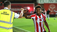 Brentford's Ollie Watkins observes Government guidelines as he celebrates with a Steward at the final whistle during Brentford vs Swansea City, Sky Bet EFL Championship Play-Off Semi-Final 2nd Leg Football at Griffin Park on 29th July 2020