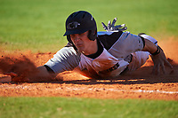 Wisconsin-Milwaukee Panthers catcher Daulton Varsho (10) dives back to first base on a pickoff attempt during a game against the Bethune-Cookman Wildcats on February 26, 2016 at Chain of Lakes Stadium in Winter Haven, Florida.  Wisconsin-Milwaukee defeated Bethune-Cookman 11-0.  (Mike Janes/Four Seam Images)