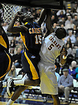 13 December 2008: Julius Coles of Canisius blocks a shot by Albany's Jerel Hastings in a game between Canisius and Albany won by Albany 74-46 at SEFCU Arena in Albany, New York.