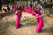 The 47-year-old leader of the Pink Gang, Sampat Pal Devi is seen teaching lathi fighting skills to Aarti, one of the young members of the pink gang. A fiesty woman, barely educated, impoverished mother of five, Sampat Pal Devi has emerged as a messianic figure in the region. Sampath Devi began to work as a government health worker, but she quit soon after because her job was not satisfying enough. She always wanted to work for the poor and not for herself. Taking up issues while being a government worker was difficult, so she decided to quit the job and work for the rights of people...Amidst the gloom of extreme poverty, it's the colour of pink that's calling the shots in this dusty region of Bundelkhand, one of the poorest parts of one of India's northern and most populous states, Uttar Pradesh in India. A gang of vigilantes, called the Gulabi Gang (pink gang) - its 10,000 strong women members wear only pink sarees - is taking up lathi (traditional Indian cudgel) against domestic violence and corruption.