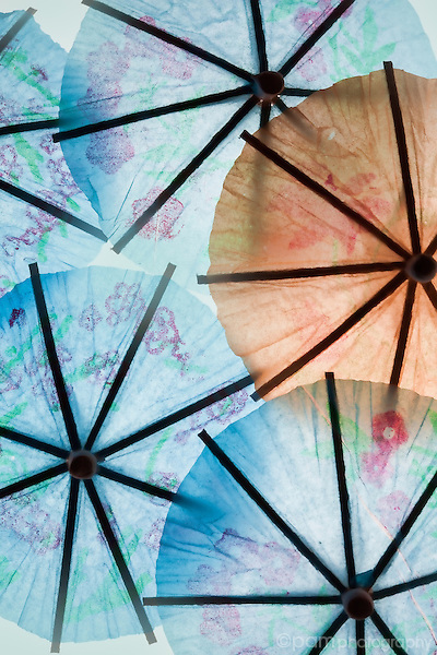 Blue and orange paper umbrellas with high-key treatment