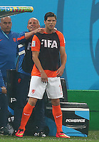 Klaas Jan Huntelaar of Netherlands gets a massage from a member of the backroom staff as he prepares to come on as a substitute