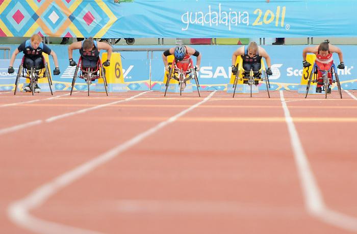 Christy Campbell and Rachael Burrows, Guadalajara 2011 - Para Athletics // Para-athlétisme.<br /> Christy Campbell and Rachael Burrows compete in the 100m - T34 final // Christy Campbell et Rachael Burrows participent à la finale du 100 m - T34. 11/17/2011.