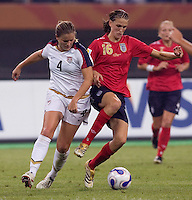 Cat Whitehill, Jill Scott. The USA defeated England, 3-0 during the quarterfinals of the FIFA Women's World Cup in Tianjin, China.  The USA defeated England, 3-0.