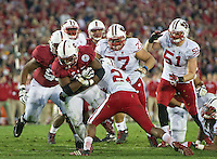 PASADENA, CA - January 1, 2013: Stanford running back Stepfan Taylor (33) carries Wisconsin tacklers during the Stanford Cardinal vs the Wisconsin Badgers game in the 2013 Rose Bowl Game in Pasadena, California. Final score Stanford 20, Wisconsin 14.