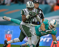04.10.2015. Wembley Stadium, London, England. NFL International Series. Miami Dolphins versus New York Jets. Jets' Corner Back Marcus Williams [#20] intercepts a pass intended for Dolphins' Tight End Jordan Cameron [#84]
