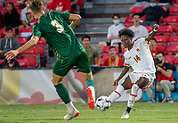 COLLEGE PARK, MD - SEPTEMBER 3: Maryland University midfielder Josua Bolma (14) shoots past George Mason University defender Valentin Brandis (3) for Maryland's first goal during a game between George Mason University and University of Maryland at Ludwig Field on September 3, 2021 in College Park, Maryland.