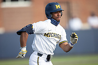 Michigan Wolverines outfielder Clark Elliott (15) runs to first base against the Michigan State Spartans on March 22, 2021 in NCAA baseball action at Ray Fisher Stadium in Ann Arbor, Michigan. Michigan State beat the Wolverines 3-0. (Andrew Woolley/Four Seam Images)