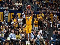 Tyrone Wallace of California shoots the ball during 2014 National Invitation Tournament against Arkansas at Haas Pavilion in Berkeley, California on March 24th, 2014.  California defeated Arkansas, 75-64.