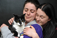 L-R: Rebbeca and Danielle with Oscar<br /> A cat named Oscar has been returned home after going missing since before last Christmas. Oscar was returned from Kent more than 200 miles from his home in Caerau, Cardiff. His owners Danielle, 27, and Rebecca, 28, Spencer are thrilled he has come home. They are urging all pet lovers to have their animals micro chipped . Rebecca, left.