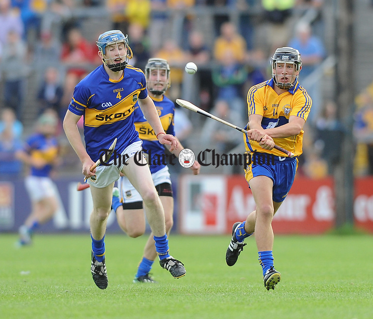 Tom Fox of Tipperary in action against David Reidy of Clare during their Munster U-21 semi final game in Cusack park. Photograph by John Kelly.