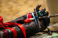 Feet of Diana R., who claims to be possessed by spirits, seen tied with ribbons before a ritual of exorcism performed by Hermes Cifuentes in La Cumbre, Colombia, 28 May 2012. Exorcism is an ancient religious practice of evicting spirits, generally called demons or evil. Although the formal catholic rite of exorcism is rarely seen and must be only conducted by a designated priest, there are many pastors and preachers in Latin America performing exorcism ceremonies. The 52-year-old Brother Hermes, as the exorcist calls himself, claims to have been carrying out the healing rituals for more than 20 years. Using fire, dirt, candles, flowers, eggs and other natural-based items, in conjunction with Christian religous formulas, he attempts to drive the supposed evil spirit out of a victim's mind and body.