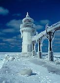 St Joseph Pier lighthouse near Benton Harbor, Michigan, on Lake Michigan after a winter storm.