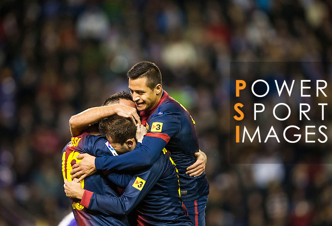 VALLADOLID, SPAIN - DECEMBER 22:  Players of FC Barcelona celebrate Xavi Hernandez's goal against Real Valladolid during the La Liga game between Real Valladolid and FC Barcelona at Jose Zorrilla on December 22, 2012 in Valladolid, Spain. Photo by Victor Fraile / The Power of Sport Images