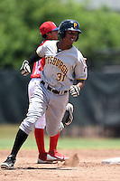 GCL Pirates shortstop Bealyn Chourio (31) running the bases during a game against the GCL Phillies on June 26, 2014 at the Carpenter Complex in Clearwater, Florida.  GCL Phillies defeated the GCL Pirates 6-2.  (Mike Janes/Four Seam Images)