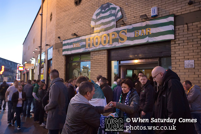 Scotland 1 Republic of Ireland 0, 14/11/2014. Celtic Park, European Championship qualifying. A man selling souvenir scarves to fans outside the Hoops Bar in the Gallowgate, Glasgow before the European Championship qualifying match between Scotland and the Republic of Ireland at the city's Celtic Park. Scotland won the match by one goal to nil, scored by Shaun Maloney 16 minutes from time. The match was watched by 55,000 at Celtic Park, the venue chosen to host the match due to Hampden Park's unavailability following the 2014 Commonwealth Games. Photo by Colin McPherson.
