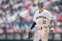 Michigan Wolverines third baseman Blake Nelson (10) during Game 11 of the NCAA College World Series against the Texas Tech Red Raiders on June 21, 2019 at TD Ameritrade Park in Omaha, Nebraska. Michigan defeated Texas Tech 15-3 and is headed to the CWS Finals. (Andrew Woolley/Four Seam Images)