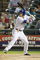 Round Rock Express outfielder Jim Adduci (24) at bat against the Oklahoma City RedHawks during the Pacific Coast League baseball game on August 25, 2013 at the Dell Diamond in Round Rock, Texas. Round Rock defeated Oklahoma City 9-2. (Andrew Woolley/Four Seam Images)