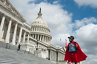 """Michael Wheeler, of Kansas City, MO, wears his """"Super Jesus"""" outfit and face mask as he shouts his message outside of the U.S. Capitol in Washington, DC., Wednesday, May 27, 2020. Credit: Rod Lamkey / CNP/AdMedia"""
