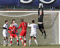 Corner kick. Amherst goalkeeper Thomas Bull (1), NCAA Division III Sectionals. In double-overtime, Amherst College (white) defeated St. Lawrence University (red), 2-1, on Hitchcock Field at Amherst College on November 23, 2013.