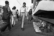 Children selling items on the streets of Bangkok, Thailand - Child labor as seen around the world between 1979 and 1980 – Photographer Jean Pierre Laffont, touched by the suffering of child workers, chronicled their plight in 12 countries over the course of one year.  Laffont was awarded The World Press Award and Madeline Ross Award among many others for his work.