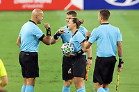NASHVILLE, TN - SEPTEMBER 23: Referee Tori Penso exchanges fist bumps with fourth official Robert Sibiga and assistant referees Logan Brown and Jeremy Hanson before a game between D.C. United and Nashville SC at Nissan Stadium on September 23, 2020 in Nashville, Tennessee.