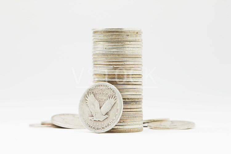 Stack of American coins on white background