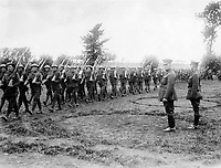 Canadian war records photograph<br /> Description<br /> <br /> Some of the Canadian Infantry marching past Gen. Sir Sam Hughes on their way to the trenches