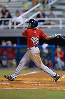 LaMonte Wade (26) of the Elizabethton Twins follows through on his swing against the Kingsport Mets at Hunter Wright Stadium on July 8, 2015 in Kingsport, Tennessee.  The Mets defeated the Twins 8-2. (Brian Westerholt/Four Seam Images)