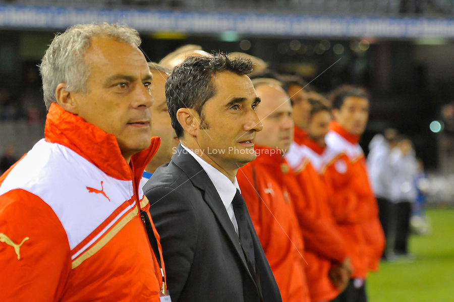 MELBOURNE, AUSTRALIA - MAY 19:  Olympiakos coach Ernesto Valverde and his bench listen to the Greek national anthem at a match between Melbourne Victory and Olympiakos FC at Etihad Stadium on 19 May 2012 in Melbourne, Australia. (Photo Sydney Low / AsteriskImages.com)