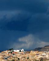 Storm clouds over the Laguna Pueblo; Laguna Pueblo, NM