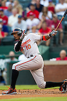 Baltimore Orioles outfielder Adam Jones #10 swings during the Major League Baseball game against the Texas Rangers on August 21st, 2012 at the Rangers Ballpark in Arlington, Texas. The Orioles defeated the Rangers 5-3. (Andrew Woolley/Four Seam Images).