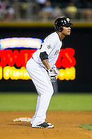 Michael Taylor (45) of the Charlotte Knights takes his lead off of second base against the Gwinnett Braves at BB&T Ballpark on August 19, 2014 in Charlotte, North Carolina.  The Braves defeated the Knights 10-5.   (Brian Westerholt/Four Seam Images)