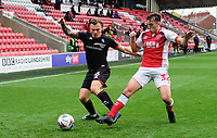 Lincoln City's Harry Anderson vies for possession with Fleetwood Town's Harrison Holgate<br /> <br /> Photographer Chris Vaughan/CameraSport<br /> <br /> The EFL Sky Bet League One - Fleetwood Town v Lincoln City - Saturday 17th October 2020 - Highbury Stadium - Fleetwood<br /> <br /> World Copyright © 2020 CameraSport. All rights reserved. 43 Linden Ave. Countesthorpe. Leicester. England. LE8 5PG - Tel: +44 (0) 116 277 4147 - admin@camerasport.com - www.camerasport.com
