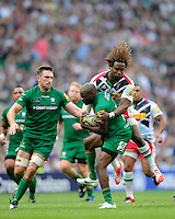 Marland Yarde of Harlequins tackles Topsy Ojo of London Irish during the Premiership Rugby Round 1 match between London Irish and Harlequins at Twickenham Stadium on Saturday 6th September 2014 (Photo by Rob Munro)