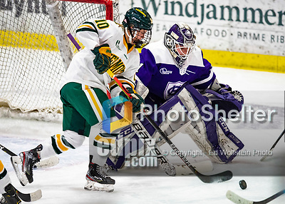 2 February 2020: University of Vermont Catamount Defender Ellice Murphy, a Sophomore from Roseau, MN, attempts to get a game winning goal against Holy Cross Crusader Goaltender Jada Brenon, a Sophomore from Pendleton, NY, in sudden death overtime at Gutterson Fieldhouse in Burlington, Vermont. The Lady Cats rallied in the 3rd period to tie the Crusaders 2-2 in NCAA Women's Hockey East play. Mandatory Credit: Ed Wolfstein Photo *** RAW (NEF) Image File Available ***