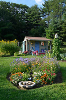 Lovely garden shed with blooming flowers, Community garden, Yarmouth, Maine, USA